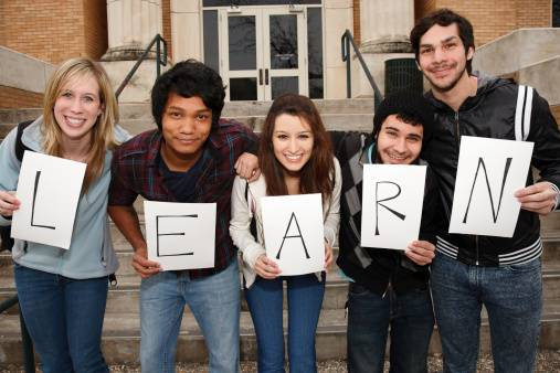 Young Group Holding Learn Sign to Signify Importance of Education